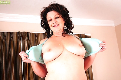 Thick and busty mature house..